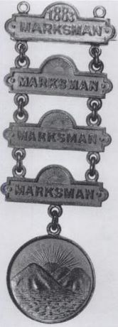 Early examples of Marksman badges from the NY National Guard. The oldest badges were placed lowest, and newer ones higher.
